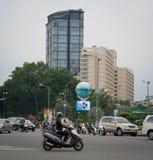 Motorbikes traffic on the street in Saigon Stock Photography