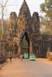 Motorbikes and Tuk tuks leave Angkor Thom Stock Images