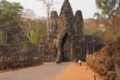 Motorbikes and Tuk tuks leave Angkor Thom Royalty Free Stock Images