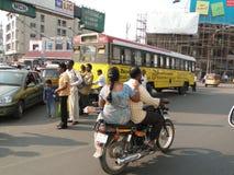 Motorbikes weave their way through traffic Stock Photo