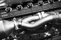 Motorblock och blåsarerör Motor V12 Royaltyfria Foton