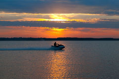 Motorboat. A motorboat and a sunset royalty free stock image