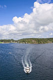 Motorboat. In fjord with cloudy weather royalty free stock photos