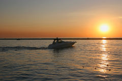 Motorboat. At sunset, captured at Michigan City Stock Photos