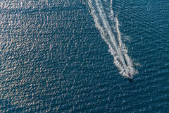 Motorboat aerial. Helicopter aerial shoot of sailboat in a sea channel, location: Croatia royalty free stock image
