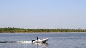 Motorboat along the river stock video footage