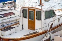 Motorboat anchored in the harbor with wooden door stock photos