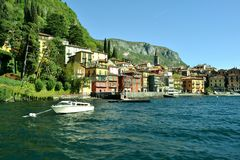 Motorboat anchored and Varenna lakefront. Stock Image