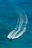 Motorboat. With an arched track at sea Stock Photos