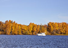 Motorboat on an autumn lake Stock Photos