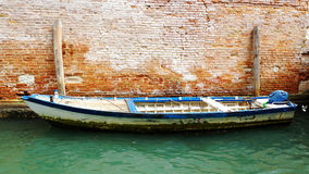 Motorboat on the background of an old brick wall, Venice, Italy Royalty Free Stock Photos