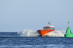 MOTORBOAT. Baltic Sea - Fast flowing motorboat and signal buoy royalty free stock images