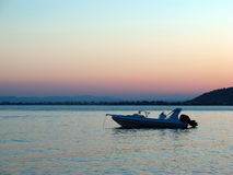 Motorboat in bay at dawn. Motorboat in the early morning off the coast of Greece stock photography