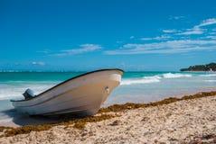 Motorboat on the beach. Of the Atlantic coast Royalty Free Stock Photo