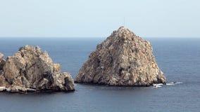 Motorboat in blue sea near cliffs stock footage