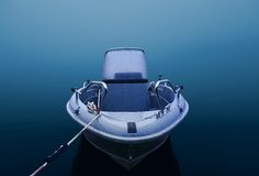 Sports fishing boat in thick fog Royalty Free Stock Image