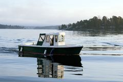 Motorboat on calm water Stock Images