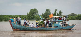 Motorboat carrying many people on Mekong river Royalty Free Stock Photo