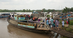 Motorboat carrying many people on Mekong river Stock Photo
