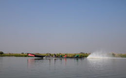 A motorboat carrying tourists on the lake in Myanmar Stock Photo