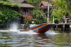 Motorboat on the channel in Bangkok, Thailand Stock Image