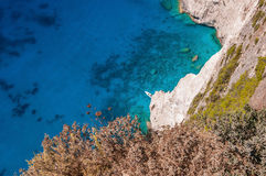 Motorboat at the cliffs of Zakynthos. Seen from the top stock photography