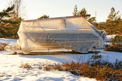 Motorboat covered with translucent white tarpaulin Stock Photography