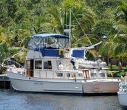 Motorboat in dock. Motor boat docked in a Florida waterway stock image