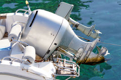 Motorboat engine. Photo of a grey motorboat engine in the sea stock photo
