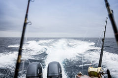 Motorboat with fishing rods Royalty Free Stock Photos