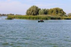 Motorboat floating in river Dnieper. Motorboat floating in the river Dnieper royalty free stock photo