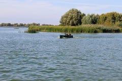 Motorboat floating in river Dnieper. Motorboat floating in the river Dnieper royalty free stock photography