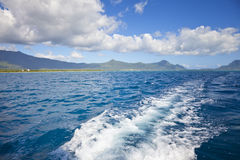 Motorboat Fun. Driving with a motorboat on the Indian Ocean at Mauritius Stock Photo