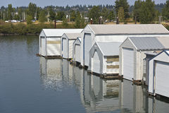 Motorboat garages on a river inlet Portland Oregon. Stock Image