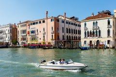 Motorboat on Grand canal. Foscari Palace, Palazzo Barbaro. Sunny day in Venice Stock Photography