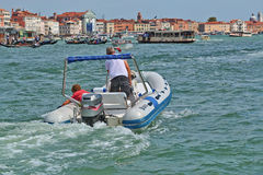 Motorboat in Grand Canal. Venice, Italy. Venice, Italy - August 21, 2015: Motorboat with passenger in Grand Canal, Venice stock images