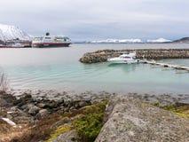 Motorboat and Hurtigruten cruise ship in Stokmarknes, Hadseloya, Vesteralen, Nordland, Norway. Motor yacht and Hurtigruten cruise ship in Stokmarknes, Hadseloya stock photos