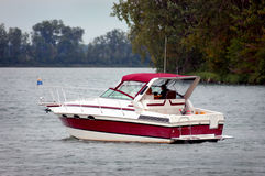 Motorboat on lake. A red motorboat on a lake stock photos