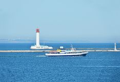 Motorboat and lighthouse Royalty Free Stock Photos