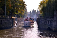 Motorboat in lock chamber on Vltava river in Prague. Travelling in Prague by a steamboat royalty free stock photo