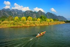 Motorboat moving on Nam Song River in Vang Vieng, Vientiane Prov. Motorboat moving on Nam Song River in Vang Vieng, Laos. Vang Vieng is a popular destination for stock images