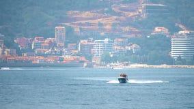 Motorboat moving at sea against Mediterranean resort scenery. Boat moving at sea against Mediterranean resort scenery stock image