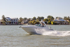 Motorboat at the Naples coast, Florida. Naples, Fl, USA - March 18, 2017: Joyride with a motorbaot in the Gulf of Mexico. Naples, Florida, United States royalty free stock photos