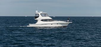Motorboat in the ocean. Small motorboat during a sunny day around Provincetown, MA, Boston royalty free stock image