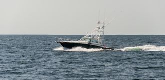 Motorboat in the ocean. Small motorboat during a sunny day around Provincetown, MA, Boston royalty free stock photography