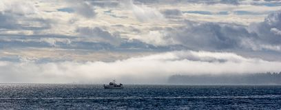 Motorboat in open sea. A motorboat in the open sea in the Pacific Northwest stock photo