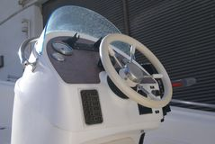 Motorboat parts. Powerboat parts. Boat parts of instrument panel & steering wheel royalty free stock image