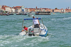 Motorboat with passenger in Venice, Italy. Venice, Italy - August 21, 2015: Motorboat with passenger in Grand Canal, Venice royalty free stock photos