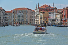 Motorboat with passengers in Grand Canal. Venice, Italy. Venice, Italy - August 21, 2015: Motorboat with passengers in Grand Canal royalty free stock photo