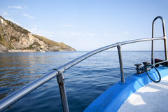 Motorboat. A powerboat traveling along the coast stock images